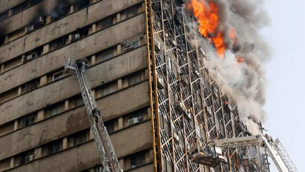Tehran fire: Twenty firemen killed as high-rise collapses
