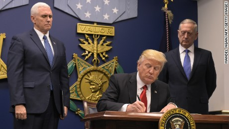 Trump signs 'extreme vetting' order to limit immigration