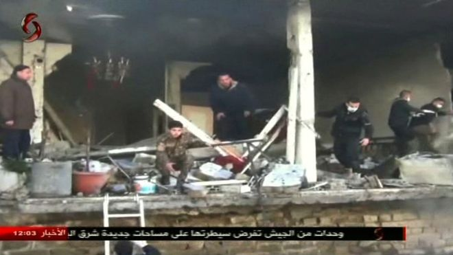 Syria: Twin attacks on Homs security bases kill dozens