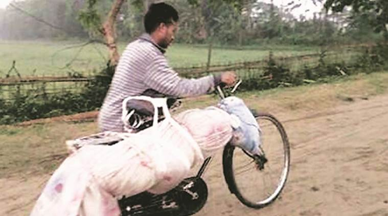 In Assam CM's constituency, man carries brother's body on cycle