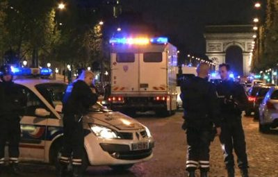 In this image made from video, police attend the scene after an incident on the Champs-Elysees with Arc de Triomphe in background in Paris, Thursday April 20, 2017.  French media are reporting that two police officers were shot Thursday on the famed shopping boulevard. (AP Photo)