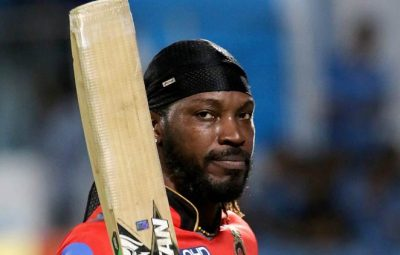 Rajkot: Chris Gayle of the Royal Challengers Bangalore walks back to the pavilion after getting out during an IPL 2017 match against Gujarat Lions in Rajkot on Tuesday.   PTI Photo/Sportzpics(PTI4_18_2017_000226A)