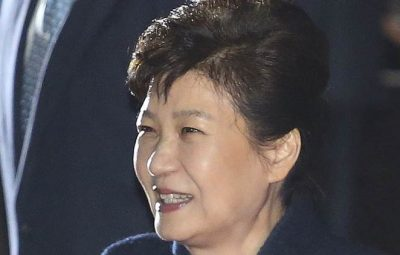 Ousted South Korean President Park Geun-hye smiles as she is greeted by supporters upon her arrival at her private home in Seoul, South Korea, Sunday, March 12, 2017. Park expressed defiance toward the corruption allegations against her as she vacated the presidential palace and returned to her home on Sunday, two days after the Constitutional Court removed her from office. (AP Photo/Ahn Young-joon)