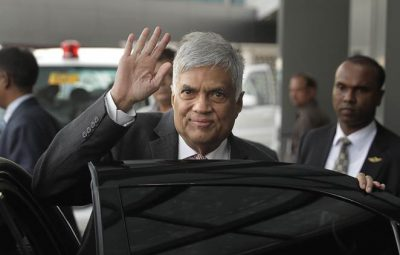 Sri Lankan Prime Minister Ranil Wickremesinghe waves to media as he arrives at the airport in New Delhi, India, Tuesday, April 25, 2017. Wickremesinghe arrived Tuesday on a five-days visit to India. (AP Photo/Manish Swarup)