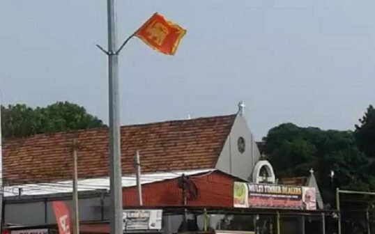 Mahasen Balakaya fly National Flags sans minority strips, outrageously, in Kilinochchi