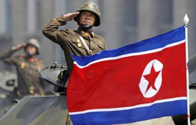 FILE - In this Saturday, April 15, 2017, file photo, a North Korean national flag flutters as soldiers in tanks salute to North Korean leader Kim Jong Un during a military parade in Pyongyang, North Korea to celebrate the 105th birth anniversary of Kim Il Sung, the country's late founder and grandfather of the current ruler. A North Korean mid-range ballistic missile apparently failed shortly after launch Saturday, April 29, South Korea and the United States said, the third test-fire flop just this month but a clear message of defiance as a U.S. supercarrier conducts drills in nearby waters. (AP Photo/Wong Maye-E, File)