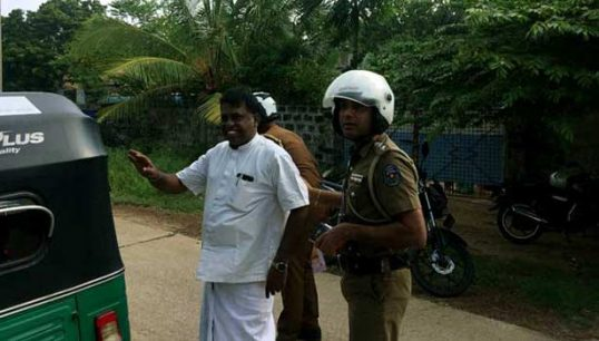 Sivajilingam arrested for attempting to celebrate Leader Pirabaharan's Birthday. Police seize cake and banner