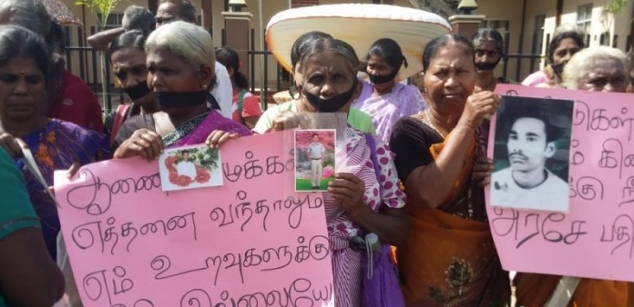 Under severe warning from Police, Relatives of Missing Persons in Trincomalee demonstrate with mouths bound with black cloths