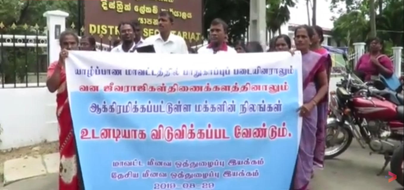 Attention drawing struggle undertaken yesterday demanding release of Lands of Tamil People