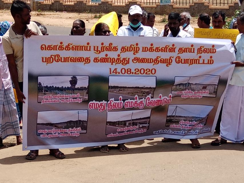 Attention drawing demonstration by people of Kokkilai against the robbing of lands
