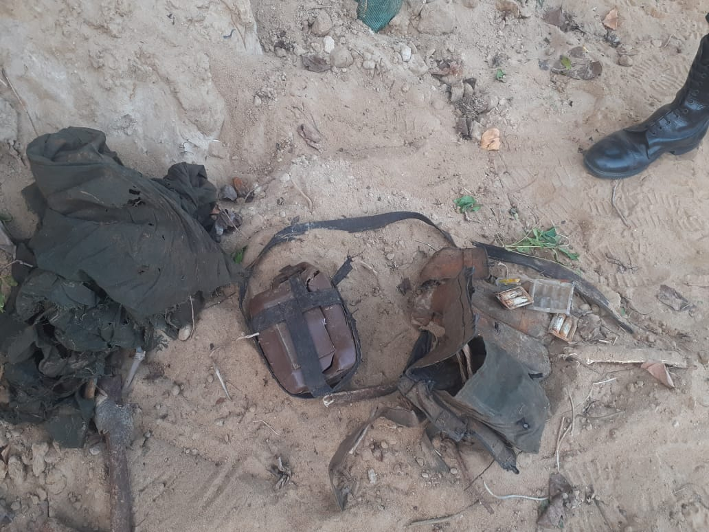 Uniforms, fragments of human leg bones and batteries recovered at Kilinochchi/Muhamalai