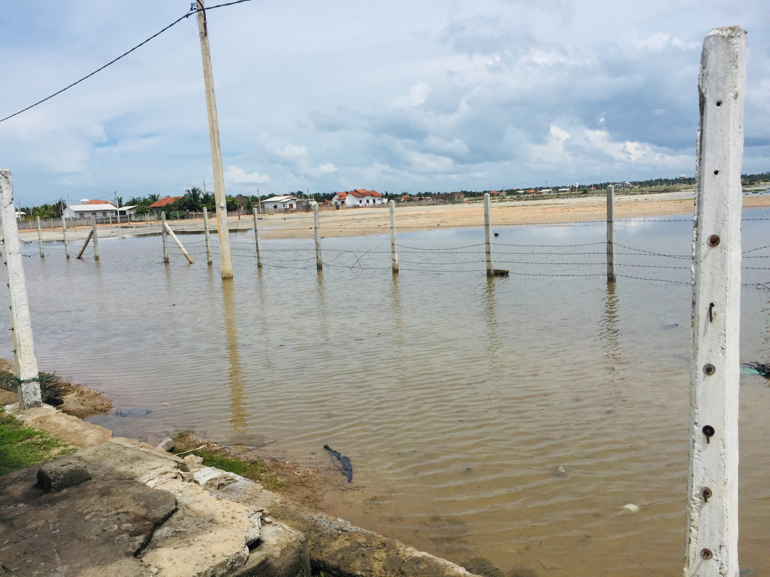 Flood water inundate houses due to drainage blocked by Fish Farm Mannar South Bar